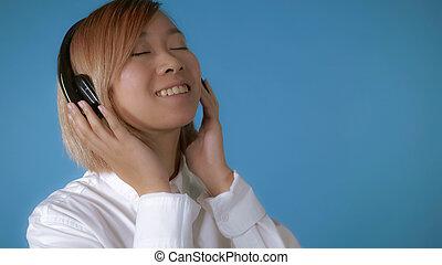 happy girl listening music earphones