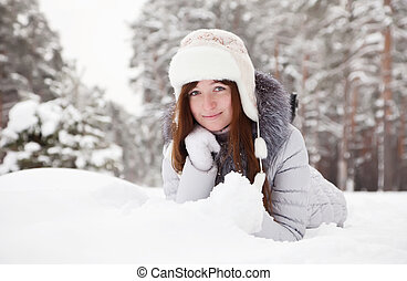girl lying down on the snow