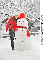 happy girl making a snowman