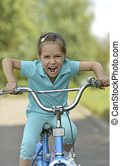 Happy girl on a bicycle
