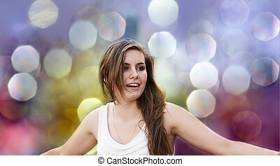 Happy girl on background of the bokeh