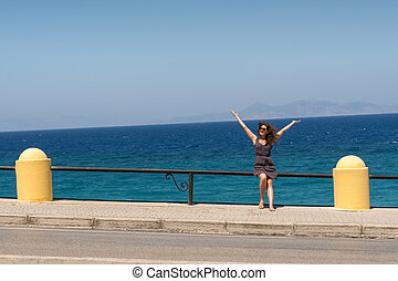 happy girl on sea background