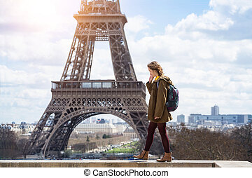 girl on the background of the Eiffel Tower
