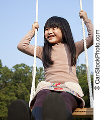 happy girl on the swing