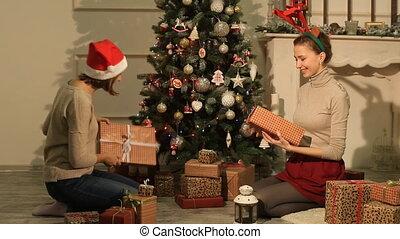 Happy girl opened Christmas gifts