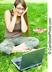 happy girl outside with laptop