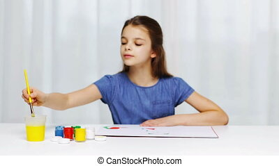 happy girl painting with gouache colour at home - people,...