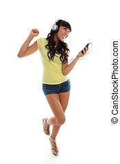 Happy girl playing music dancing - A happy vivacious girl...