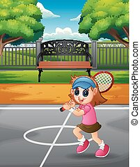 Happy girl playing tennis at the courts