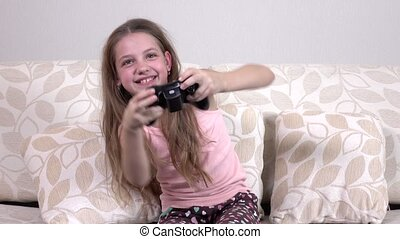 Happy girl playing video games