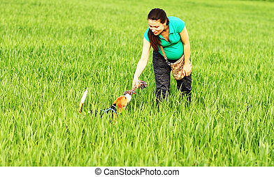 Happy girl playing with beagle dog