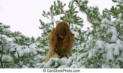 Happy Girl Playing With Snow In Forest