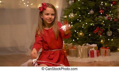 happy girl playing with sparklers at christmas - holidays,...