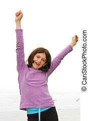 Happy girl - Portrait of a young girl on sea shore with arms...