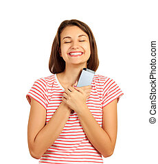 happy girl pressed the phone with both hands to her chest and dreams of joy from messages. emotional girl isolated on white background