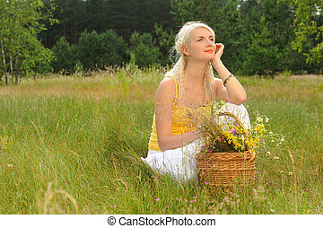 Happy girl relaxing on a meadow