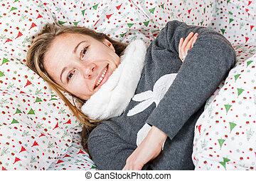 Happy girl resting in bed