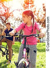 Happy girl riding a bike