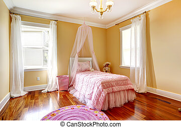 Happy girl room with pink canopy bed