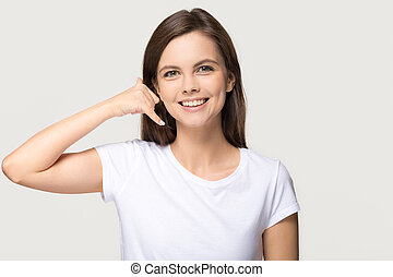 Happy girl showing call me phone gesture isolated on background
