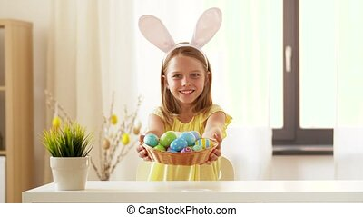 happy girl showing colored easter egg at home - easter,...