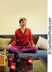 Happy girl sitting in lotus pose