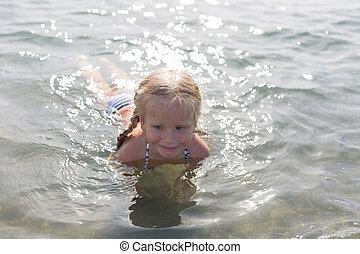 happy girl sitting in the sea