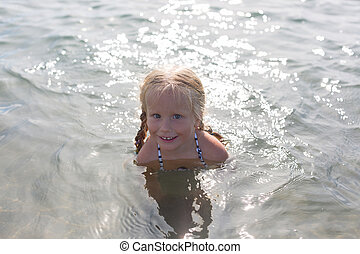 happy girl sitting in the sea
