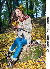 happy girl sitting on stump