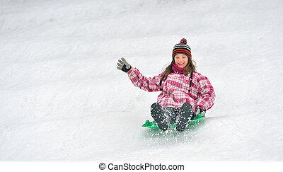 girl sliding on sled
