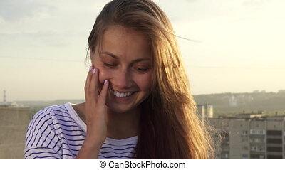 Happy girl smiling looking at camera