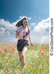 happy girl - Happy girl running through a field of flowers