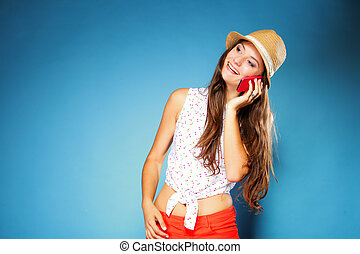 Happy girl talking on mobile phone