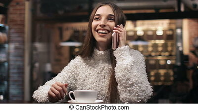 Girl Talking on Phone in Cafe