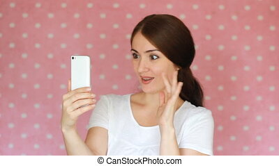 Happy girl talking on video communication and web camera. Chatting, social networking, dating