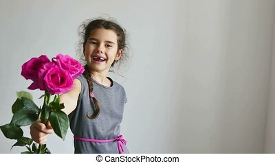happy girl teen gives flowers roses - happy girl teen gives...