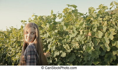 Happy girl touches the vine - Happy girl touching the vine