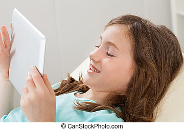 Happy Girl Using Digital Tablet