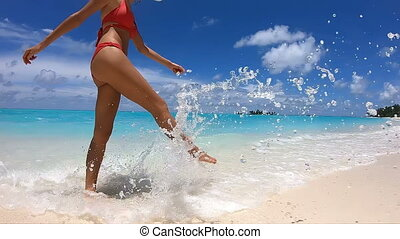 Happy Girl Walks on the Beach on Maldives. GoPro 240 fps...