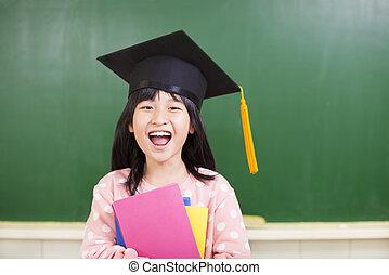 happy girl wear a graduation hat with blackboard