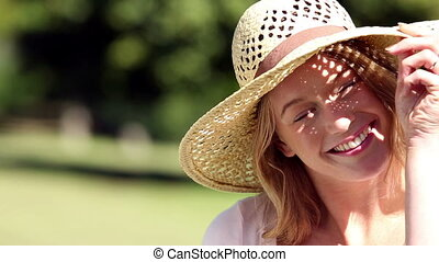 Happy girl wearing a straw hat