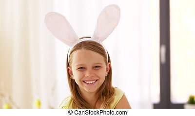 happy girl wearing easter bunny ears headband - easter,...