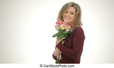 Happy girl with a bouquet of flowers