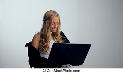 Happy girl with a laptop - isolated over a white background