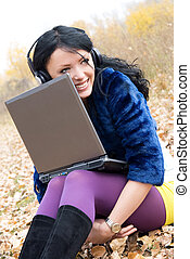 happy girl with a laptop outdoor