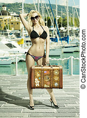 happy girl with bikini and bag