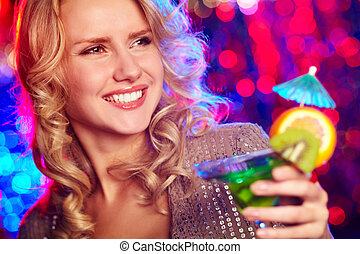 Happy girl with cocktail