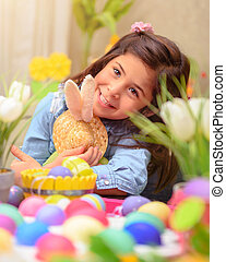 Happy girl with Easter bunny toy