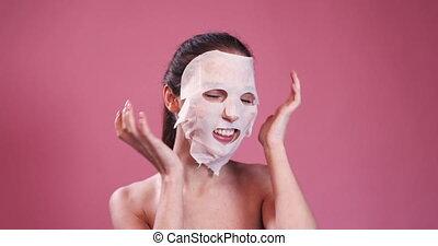 Happy Girl with Facial Mask Having Fun