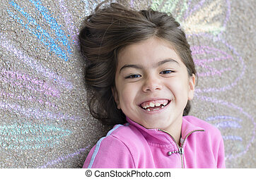 Happy Girl with her drawing on sidewalk